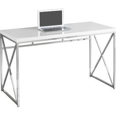 Sleek and contemporary, this walnut finished desk is the perfect combination of function, durability and design in a modern form. With clean lines, a floating top work station and sleek track metal legs, this piece will add pizzazz to any home office. Featuring an open concept shelf accented by silver colored drawer pulls to help keep your office supplies and documents organized and desktop clutter free. The large thick paneled surface provides plenty of room to meet your working needs…