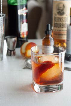 Manhattan w/ Orange Bitters: 2 oz. whiskey or bourbon, 1 oz. sweet vermouth, dash of Angostura bitters, dash of orange bitters, orange peel rubbed around rim & for garnish