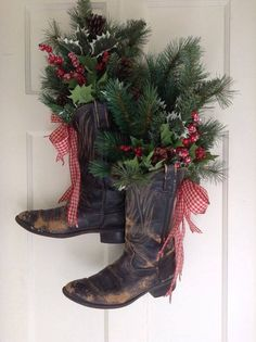 Black boots with Faux Greens Red Frosted Berries Holly and Red Gingham bow - Men's Boots - Ideas of Men's Boots - Vintage Cowboy Boot Christmas/Holiday Front Door Arrangement. Cowboy Christmas, Christmas Door, Primitive Christmas, Country Christmas, Outdoor Christmas, Vintage Christmas, Christmas Holidays, Primitive Fall, Christmas Trees