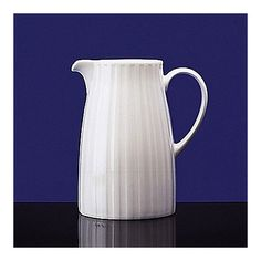 Features:  -Fluted pattern.  -Dishwasher, microwave, and oven safe.  Product Type: -Pitcher.  Material: -China.  Color: -White.  Capacity: -16 Fluid Ounces.  Dishwasher Safe: -Yes.  Style: -Solid. Dim