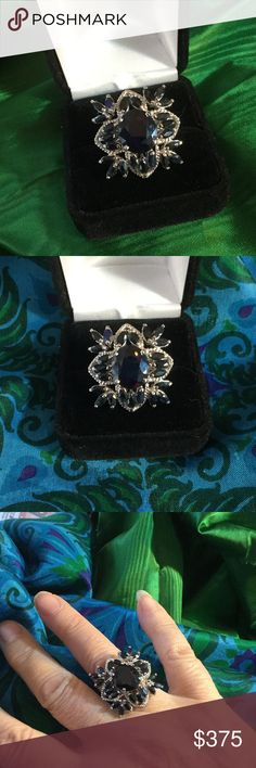 Breathtaking Genuine Sapphire Ring ! This genuine Sapphire ring is a work of art,  with an Art Deco style setting !  If this was set in 14k gold it would be a few thousand dollars !  This is a drop dead gorgeous ring set in Sterling silver with a large faceted oval surrounded not marquis cut Sapphires ! Antique Auction Jewelry Rings