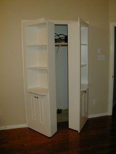 Hidden shelves | Double hidden door with three shelves and two cupboards ajar