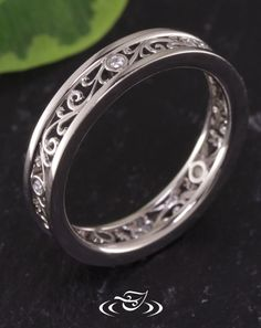 Custom CAD/Cast 950 platinum wedding band with 5 bezel set round cut diamond melee evenly spaced around band. Filigree in open panels around band with 1mm high rails. - See more at: http://www.greenlakejewelry.com/gallery/cust_gallery.aspx?ImageID=97228#sthash.3KeM5eBV.dpuf