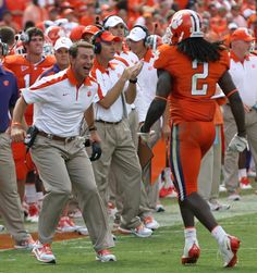 Football Coach Dabo Sweeny shows excitement as Sammy Watkins walks off the field.