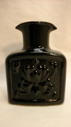 tiara black glassware | Tiara Black Glass Water Bottle: Woodstock Antiques  Consignments Antique Glass Bottles, Antique Glassware, Glass Water Bottle, Flower Lights, Black Glass, Woodstock, Black Beauty, Objects, Pottery