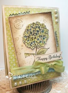 Stampin Up Because I Care - coloured with SU inks.  I like the lo and the colours.  Wouldn't have thought of using so much green on a hydrangea, but it's lovely.