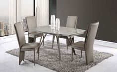Give your dining room some elegant sophistication with this contemporary glass top dining table and matching taupe leather chairs, which is sure to be the focal point of your dining space. This champagne painted glass dining table is the wow factor you have been looking for. If your dining room crav...