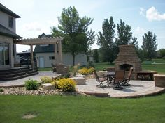 Outdoor Living, Patio Cover, Fireplace, Backyard Patio  Backyard Landscaping  Signature Landscapes Inc.  Fargo, ND