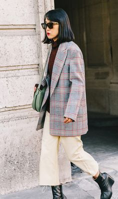A plaid coat instantly makes a basic turtleneck look chic.