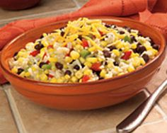 Southwest Corn & Rice with Black Beans -   Combine rice, corn and black beans in a 10-inch nonstick skillet.  Cook over MEDIUM heat until heated through. Season with salt and pepper, if desired.  Serve sprinkled with cheese.