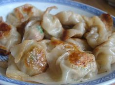 Shrimp & Pork Chinese Pot Stickers ••• Ingredients: cabbage, salt, peeled and deveined shrimp, ground lean pork, light soy sauce, rice wine (or white wine), green onion, sesame oil, fresh ginger, garlic cloves, wonton wrappers, vegetable oil, chicken stock ••• Get the recipe @ http://www.food.com/recipe/chinese-pot-stickers-13320