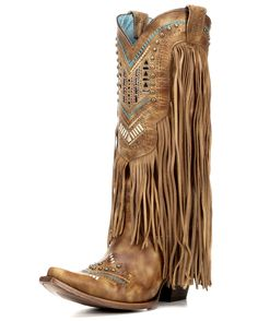 <p>Be a stylishly dressed cowgirl by completing your outfit wearing these uniquely-designed women's boots. Handcrafted in honey distressed leather, these boots stand out in fashionable flair with fringe details covering the shafts and studded turquoise & white tribal pattern embroidery designs on the shafts & feet.</p><p>Soft lining and cushioned insoles provides much comfort for long wear. Dip openings and pull straps help in making dressing easier. Snip toes, leather outsoles ...