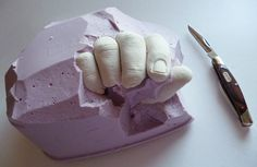 DIY hand of plaster by Mom Spark™, fun idea for casting on the wall as hooks