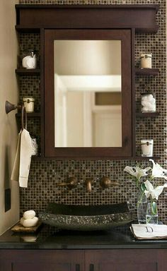 Bronze & Chocolate Mosaic Wall with an Iron sink for a Contemporary and Masculine feel
