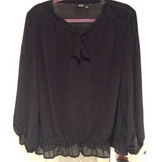 Black sheer top. Great for the holidays Black sheer top with elastic waist with small ruffles. Beads on each shoulder This is a great holiday shirt. Never worn no tags. Just hanging in the closet. No trades no pet no smoke house Tops Blouses