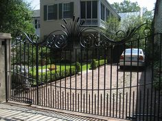 Wrought iron gate. Driveway. Beautifying curb cuts. Southern culture. Charleston, SC.