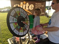 Last weekend Elite Sports Clubs once again had the opportunity to sponsor and participate in the Gathering on the Green music & performing arts festival and Run on the Green 5k Trail Run/Walk & Youth Fun Run in Mequon. Buy this Prize Wheel at http://PrizeWheel.com/products/tabletop-prize-wheels/tabletop-black-clicker-prize-wheel-12-slot/.