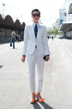 You may have come across Esther Quek, the group fashion director at The Rake, as you've browsed through Fashion Week street-style photos, but if this is your first time setting your sites on the menswear enthusiast, you're in for a treat. Quek, a short-hair-sporting, suit-loving editor based in Dubai, initially got my attention when she burst on the scene in her bold two-piece sets. While her looks always include a tie, pocket square, or sometimes both, the editor also includes girly ...