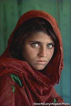"""WHO could forget those piercing green eyes staring out from a ragged, rust-coloured scarf on the cover of the June 1985 issue of National Geographic? Taken nearly 30 years ago by Steve McCurry, an American photojournalist, this memorable photograph, known as the """"Afghan Girl"""", has remained embedded in people's minds."""