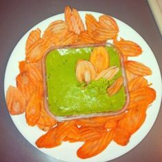 Paleo snack - Carrot chips and guacamole. Pretty. Think I would rather make them sweet potato chips or maybe a mix of both.