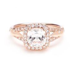 This cushion-cut diamond engagement ring setting features unique details on either side of the pave diamond-encrusted setting.  Anna Sheffield at Greenwich Jewelers