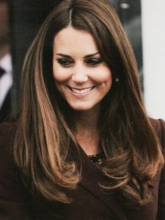 The Duchess of Cambridge at the Havelock Academy , Grimsby. Kate knows long hair is more beautiful . good for her