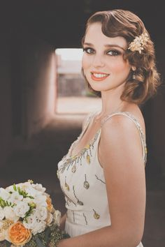 Love the finger waves in her hair. Gorgeous look for an old hollywood/art deco wedding!