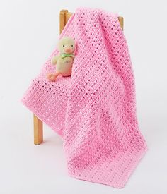 Crochet this baby blanket using Caron One Pound yarn.