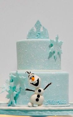 take out olaf, remove, snowflakes and replace with sugar flowers (peonies or something) remove tiara on top, replace with 30 topper,