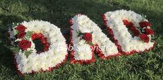 A beautiful 'DAD' sympathy wreath in white with a red contrasting ribbon and sprays of deep red roses, embellished with a white feather dove. Funeral Floral Arrangements, Flower Arrangements, Dad Funeral Flowers, Corona Floral, Cemetery Decorations, Funeral Ideas, Funeral Tributes, Memorial Flowers, Memorial Ideas
