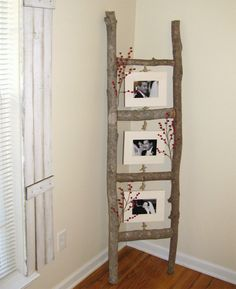 Create a beautiful photo ladder with a few branches and some wooden picture frames