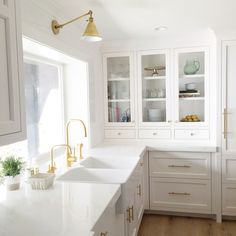 love this beautiful white kitchen. I wont have gold sink taps as they will have to be polished constantly.