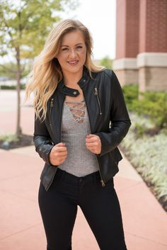 Faux leather jacket black. This trendy faux leather jacket is perfect for Fall! Cropped length. Moto style. Model is 5'7 size 27 wearing medium. 85% viscose 15% polyester.