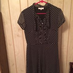 Dressbarn dress Beautiful black dress with light silver dots small collar around back snd hangs in the front four white buttons that look like pearls. Dress is lined. Has a zipper in the side. Dress Barn Dresses Midi