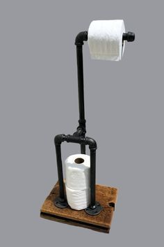 Industrial toilet paper holder/stand made from unfinished iron pipe fittings with a natural gunmetal color. You can chose 3 different colors for the metal pipe Gun Metal as scene in the pictures, Black , or Oil Rubbed Bronze. -Measures 29 inches high by 12 inches long by 8.5 inches wide. -It holds one roll at the top and three extra rolls on the bottom. -The metal pipe is cleaned and finished with 2 coats of a clear water based finish for the gun metal color, and cleaned and finished with 2…