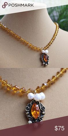 Amber glass pearls vintage beaded necklace Description of item:  •	amber glass reclaimed vintage and freshwater pearl victorian game of thrones gemstone necklace 16 inches long with semiprecious amber glass bicone beads.  •	gold plated simple clasp.  •	Vintage find pendant with cluster of pearls.  No other like it.  One of a kind!!!  •	Perfect gift item for a loved one. Great for any occasion    ~Buy here with confidence~ Jewelry Necklaces