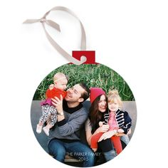Make your holiday greeting stand out by turning your family photo into an extra-special ornament card.