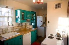 brightly painted kitchens | This kitchen is nothing special but the brightly painted cabinets add ...