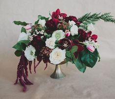 DIY winter floral centerpiece with the Pantone 2015 color of the year: Marsala, diy floral arrangements Winter Floral Arrangements, Wedding Arrangements, Flower Arrangements, Burgundy Floral Centerpieces, Table Arrangements, Winter Wedding Centerpieces, Wedding Table, Wedding Decorations, Party Centerpieces