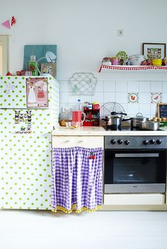 white Kitchen with green polka dot fridge; tassel fringes; red and blue;  by jasna.janekovic, via Flickr