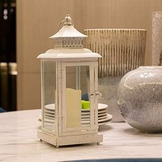 Rustic lanterns are popular this year in home decor for their warmth and charm. Decorate them to make bold statements or simply incorporate them to compliment your decor Rustic Lanterns, Popular, How To Make, Home Decor, Decoration Home, Room Decor, Popular Pins, Home Interior Design, Home Decoration