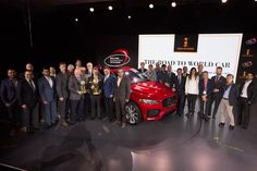 Jaguar F-Pace with WCOTY jurors at the New York auto show.