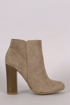These booties feature a round toe design, stitching accents, and side zip closure. Finished with a cushioned insole, smooth lining, and chunky stacked heel.    Material: Vegan Suede (man-made)  Sole: Rubber