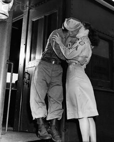 A military couple kiss goodbye at Camp Patrick Henry on August 11, 1945 as he gets on a train for a new placement.