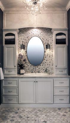 Tile and chandelier. Master bath.