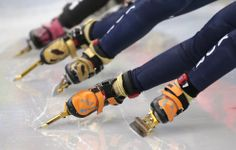 Kim Alang of South Korea, right, and Cho Ha-ri of South Korea compete in a women's 1500m short track speedskating semifinal at the Iceberg Skating Palace, on February 15, 2014. (AP Photo/Bernat Armangue)