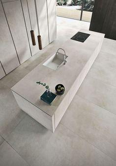 Textured finish of the kitchen island sets it apart visually #ContemporaryInteriorDesignkitchen