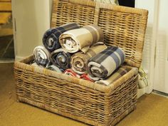 A hamper of blankets for cosy living rooms but tidy sofas?