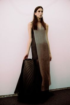 Long, layered pleated dress backstage at Yang Li SS15 PFW. More images here: http://www.dazeddigital.com/fashion/article/21922/1/yang-li-ss15
