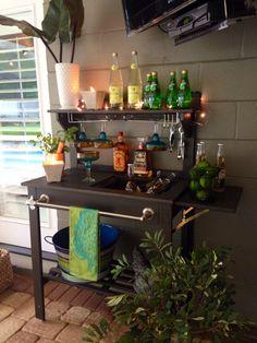 World Market potting bench turned beverage bar! I added towel bar, bottle opener, wine rack and used sink for ice!! Simple!!